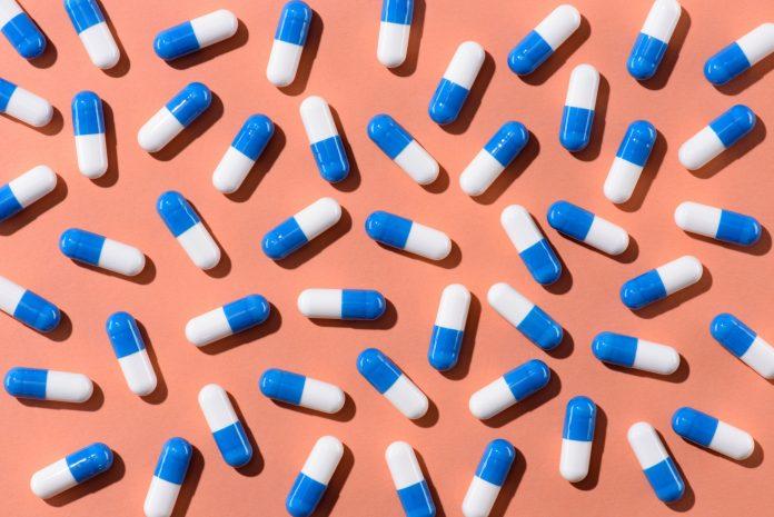 top view of pills on orange tabletop